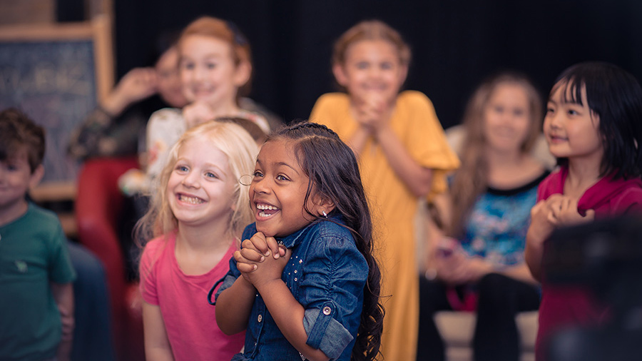 Excited group of kids in children's acting course